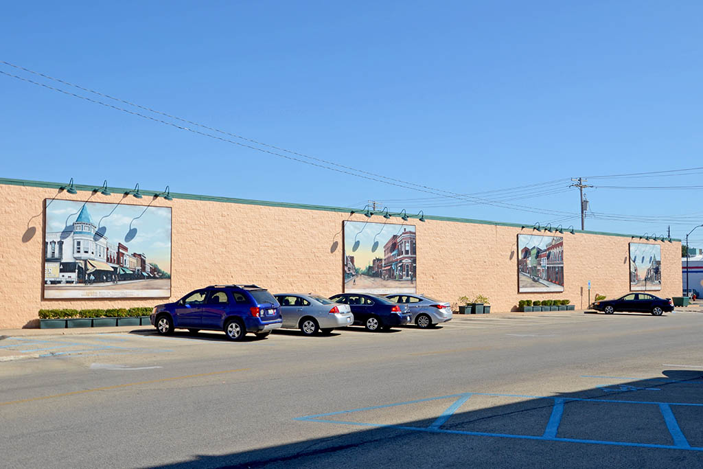 Four murals displaying historic scenes of downtown Canton, IL. Murals are hung on the south wall of the JCPenny building.