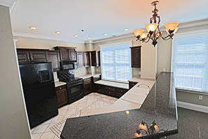 Spacious kitchen with lots of storage, a bay window, and an eat at countertop.