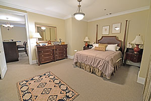 The Kirkwood, Monarch floor plan, offers a spacious master bedroom with an adjoining bathroom and walking closet.