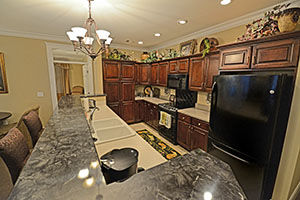 The Kirkwood, Monarch floor plan, offers a spacious kitchen with a built-in eat-at countertop.