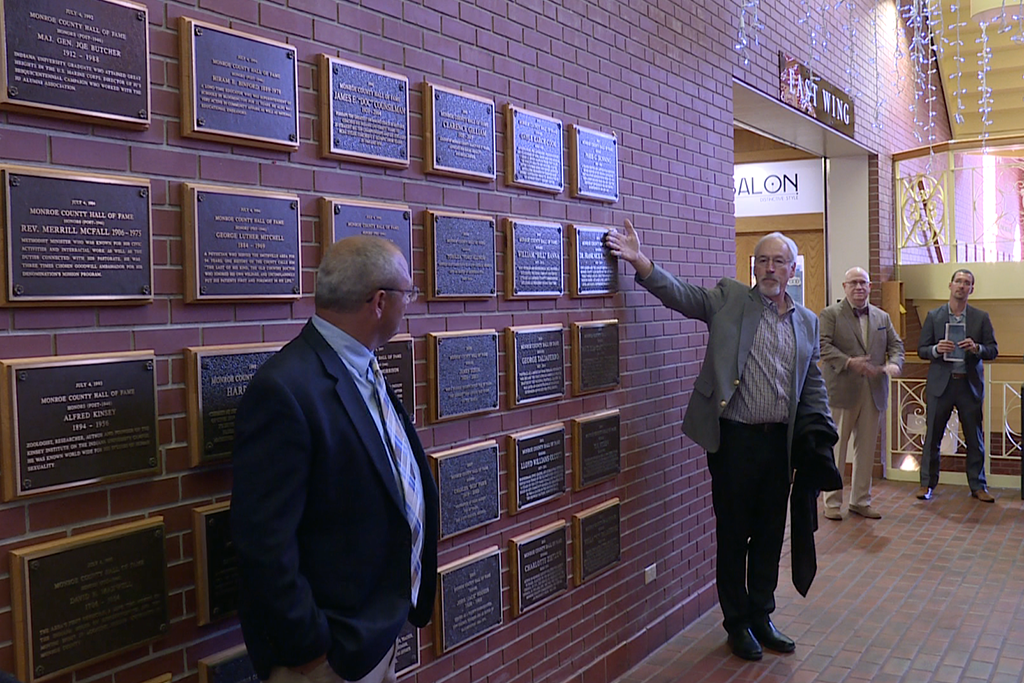Jim Murphy reveals the new Monroe County Hall of Fame plaques.