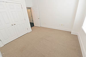 The Kirkwood, Uptown Senate, bedroom 2 comes with a spacious closet and large window.