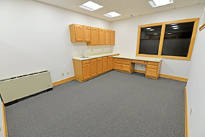 Fountain Square, Suite 230, offers a spacious room with a kitchenette.