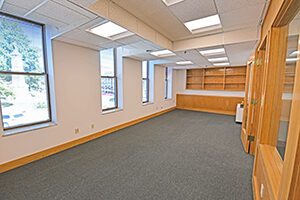 Spacious room overlooks the downtown square and provides builtin shelves.