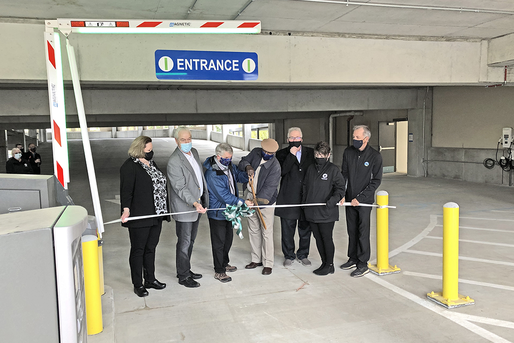 Representatives supporting the Trades District Garage cut the grand opening ribbon.