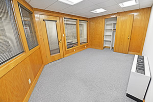 This spacious office provides multiple windows and storage.