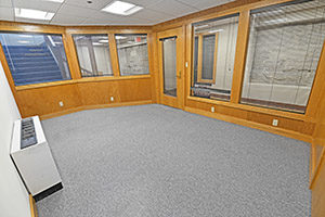 This spacious office provides multiple windows.