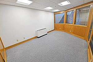 This spacious office provides multiple windows and unique characteristics.